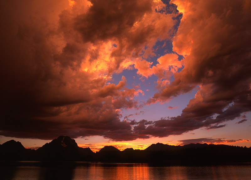 I used a wide-angle lens to emphasize the clouds in this brilliant sunset from the summer of 2006.