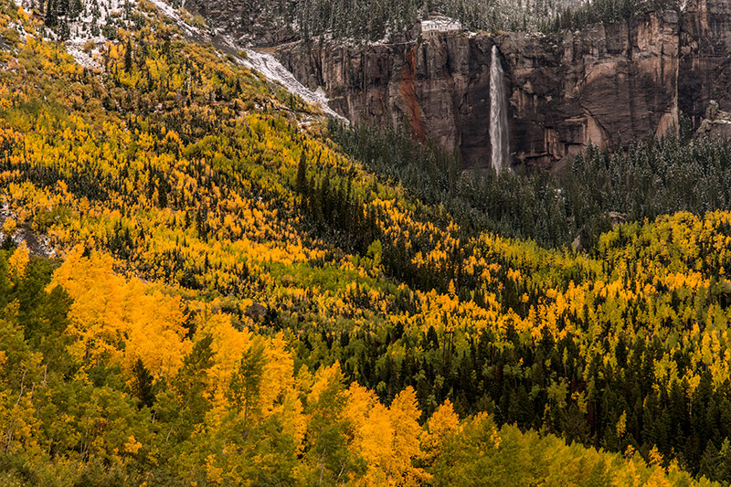 365-foot Bridal Veil Falls overlooks Telluride on a brilliant autumn day. The old Smuggler-Union Hydroelectric Power Plant was...