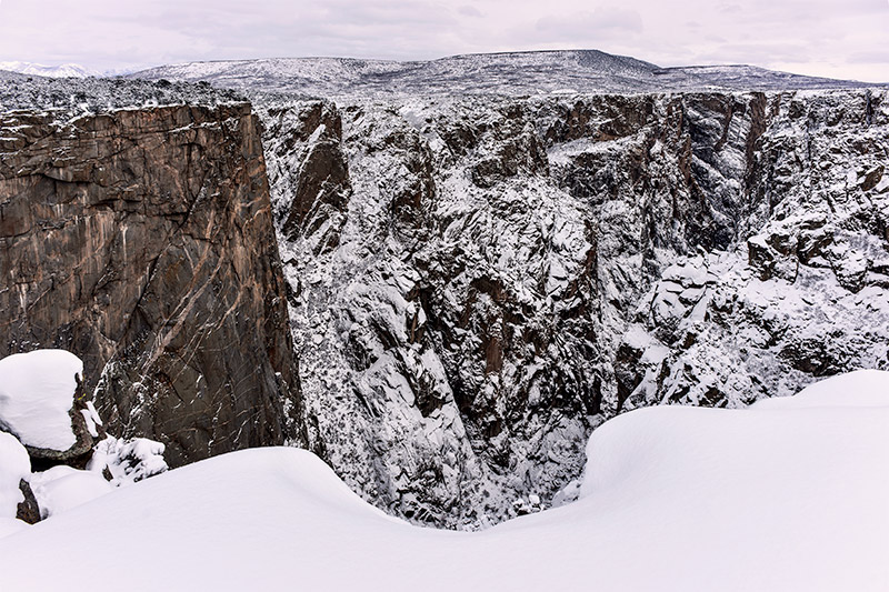 The Black Canyon of the Gunnison River narrows to its smallest width near Chasm View, a spectacular vantage point for getting...