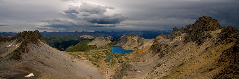Columbine Lake sits in a glacial bowl surrounded by ridgelines and peaks above 13,000 feet. The intense blue color of the...