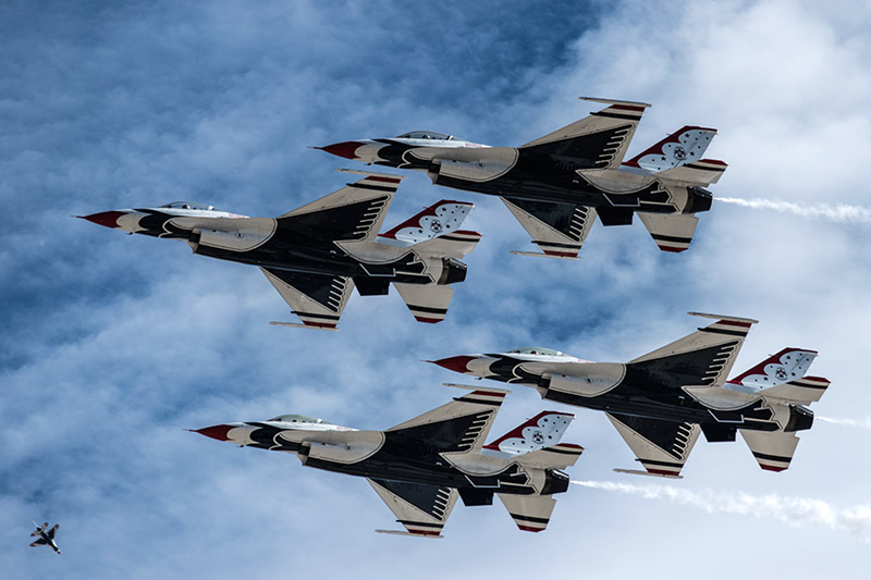 The U.S.A.F. Thunderbirds make a pass in their diamond formation during the West Star Aviation Airshow in Grand Junction, October...