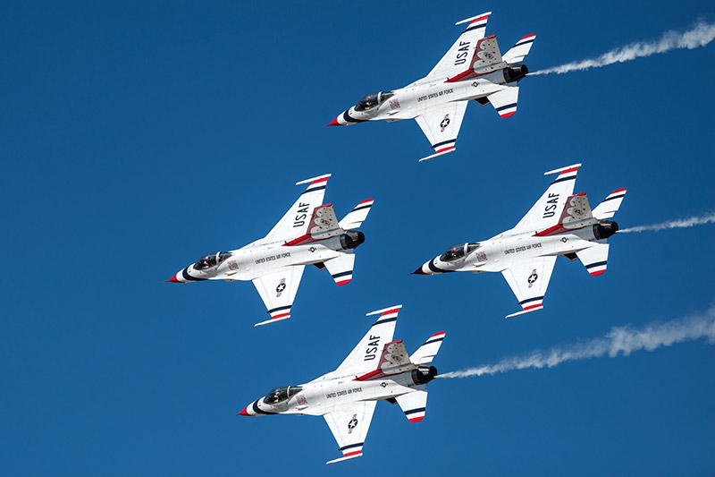 The U.S.A.F. Thunderbirds make a pass in their diamond formation against a gorgeous sky during theWest Star Aviation Airshow...