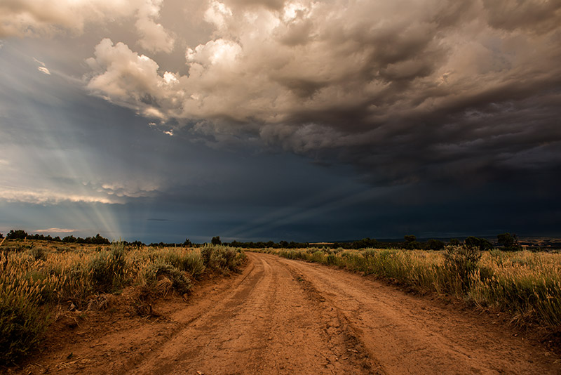 Much better than yellow bricks: Colorado dirt. A clearing storm at sunset in the McInnis Canyons National Conservation Area.