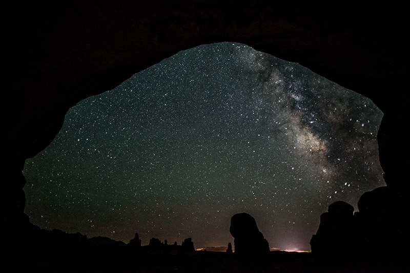 The front part of Double Arch acts as a frame for the night sky.