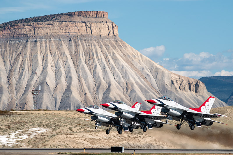 The U.S.A.F. Thunderbirds take off in front of Mount Garfield to begin their part of theWest Star Aviation Airshow in Grand...