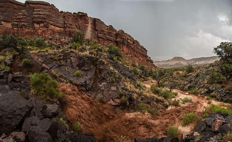 At the end of perhaps the heaviest rain I've ever seen, water poured off this cliff on the eastern side of the Colorado National...