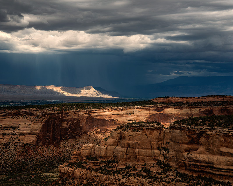 I made this photograph from Artist's Point in the Colorado National Monument, but my primary interests were the dark clouds and...