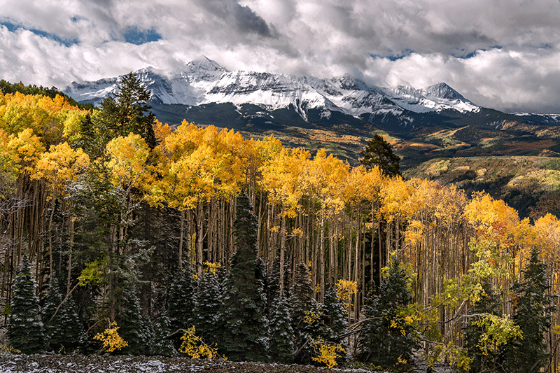 Clouds from a late-September storm cling to Mt. Wilson as the foreground aspens pick up bits of sunlight.