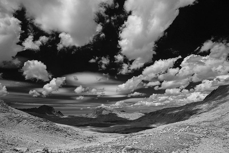 This view from Muir Pass (11,955') looks into the upper part of Evolution Basin and lies well above tree line, giving it a feeling...