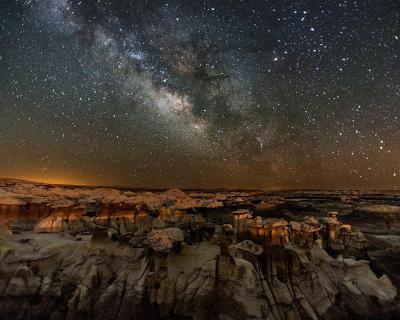 The rock formations, some of which strikingly resemble different varieties of mushrooms, of the Bisti Wilderness look as though...
