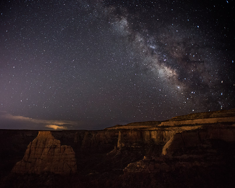 The Milky Way shines over Monument Canyon in this view from the end of Otto's Trail.