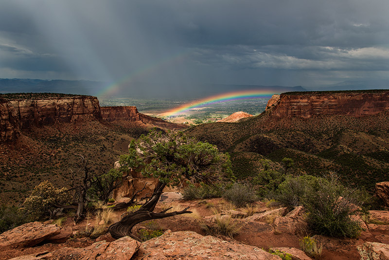 As an intense storm retreated from the Colorado National Monument, these rainbows appeared at Grand View.