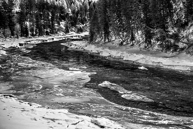 Layers of snow and ice encase the banks at this bend of the Snake River between Hoback Junction and Alpine. Nothing about...