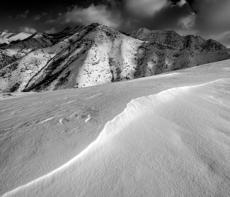 The wind blows Utah's famously dry snow into interesting ridgelines and patterns just a few miles from downtown Salt Lake City...