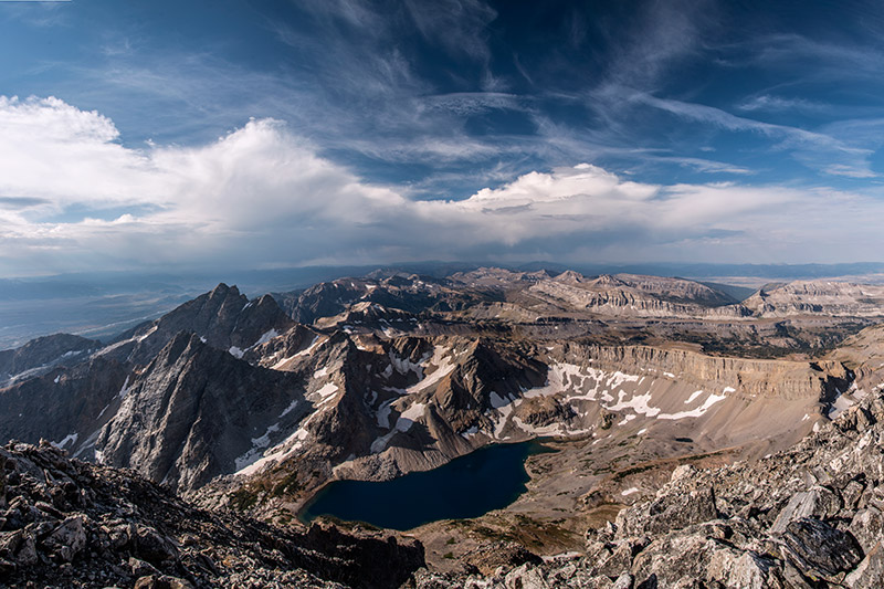 I got this view of Snowdrift Lake and The Wall by looking south-southwest from the summit of South Teton. The Wall is the...