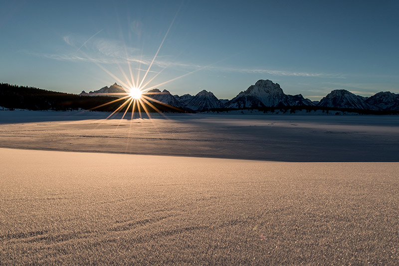 What I wanted in this image: the sun setting in a gap between the major peaks, a starburst effect for the sun, and fine...