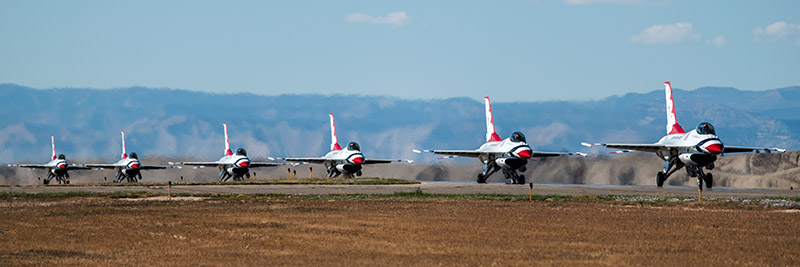 The U.S.A.F. Thunderbirds taxi back up the runway at the conclusion of their part in theWest Star Aviation Airshow in Grand...
