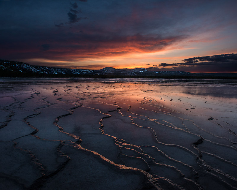 Grand Prismatic Spring, Yellowstone's hottest spring, is better known for its own deep colors. In making this image, I...
