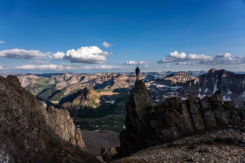 This view of upper Yankee Boy Basin, Gilpin Peak (13,694', far right), and Stony Mountain (12,698', left of center) is heart-...